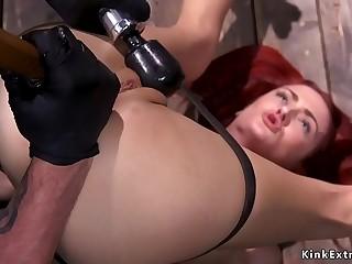 Slim redhead in bondage anal toyed