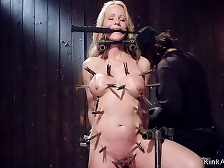 Clamped blonde Mummy in device restrain bondage