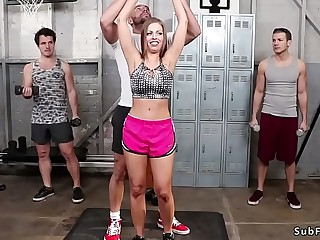 Dark-haired tied up gangbang fucked at gym