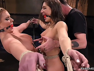 Fastened up lesbos hard whipped in dungeon