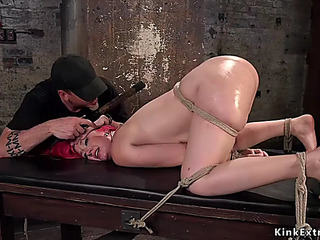 Breasty redhead with large butt takes hogtie