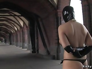 Naked masked blonde kneeling in public