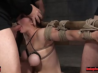 Submissive slave gagging on cock in bdsm orgy