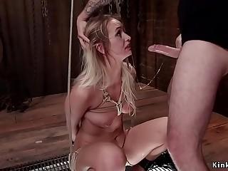 Blonde in rope bondage sitting on Sybian