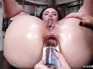 Lesbian sub takes huge toys up her ass