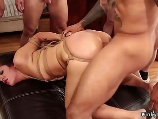 Brunette in bondage gets group facial