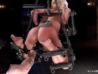 Waxed blonde in device bondage toyed