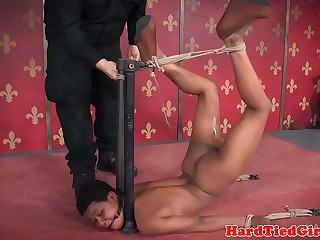 Ebony babe is tied in all sorts of shapes